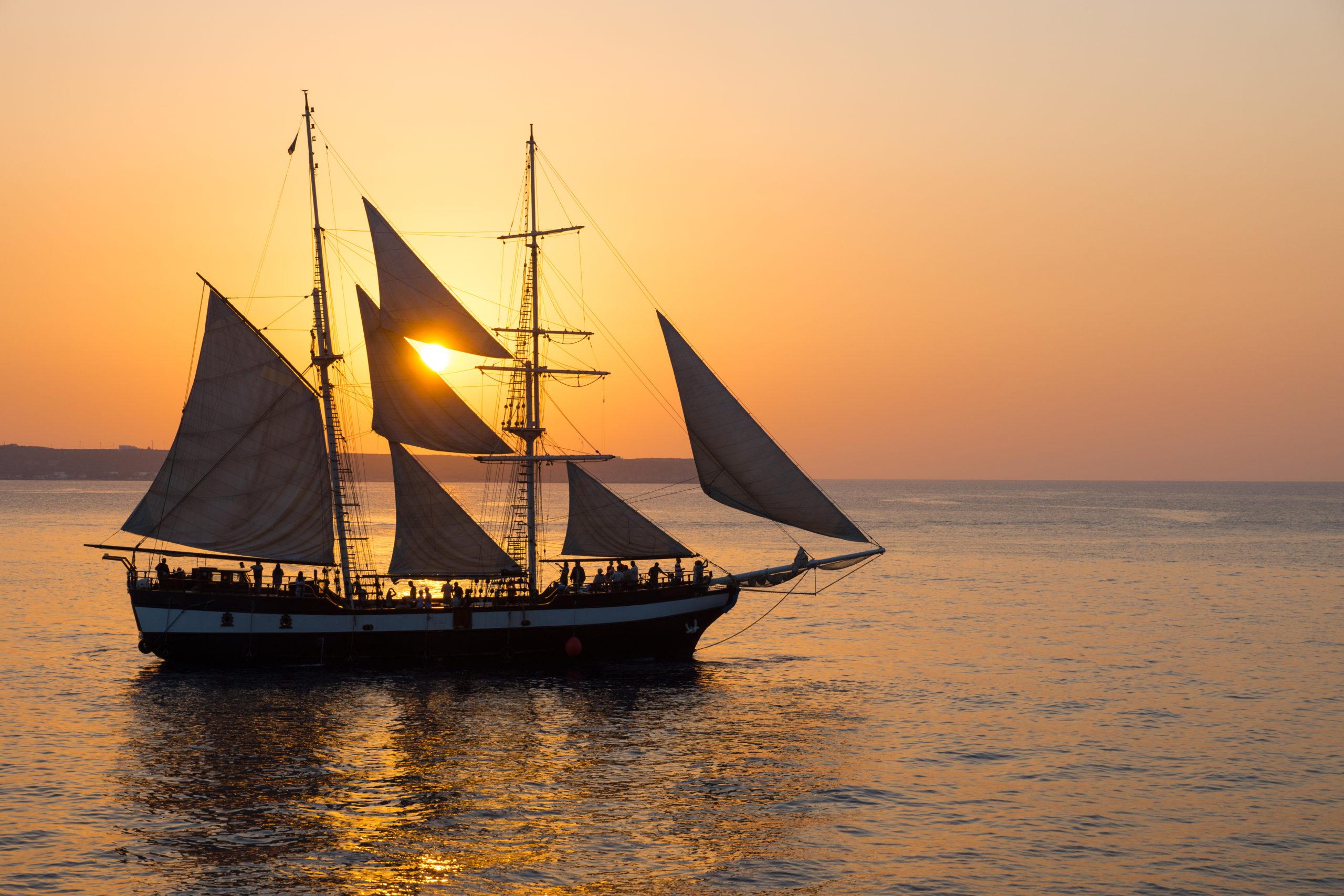 sailing-ship-at-sunset-P6U4ECE-scaled